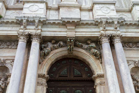 ancient architecture: Venice, Italy - April 1, 2013: Street views of ancient architecture in Venice, Italy. Venice is a city in northeastern Italy sited on a group of 118 small islands separated by canals and linked by bridges.