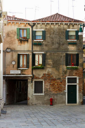 sited: Venice, Italy - April 1, 2013: Street views of ancient architecture in Venice, Italy. Venice is a city in northeastern Italy sited on a group of 118 small islands separated by canals and linked by bridges.