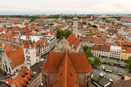 Munich, Germany- May 31, 2016: Rooftop view of Munich. Munich, Bavaria's capital, is home to centuries-old buildings and numerous museums. Stok Fotoğraf - 63764682