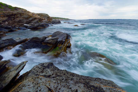 View of the rugged ocean rocky shore.