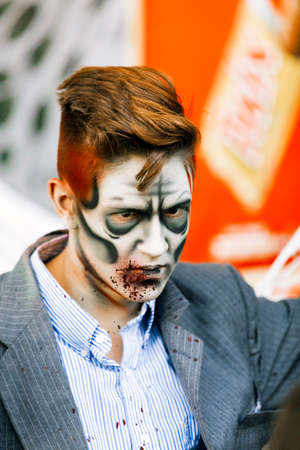 entertaining: Jackson, USA-September 24, 2016: Street performer in Halloween costume and makeup is entertaining crowds. Editorial