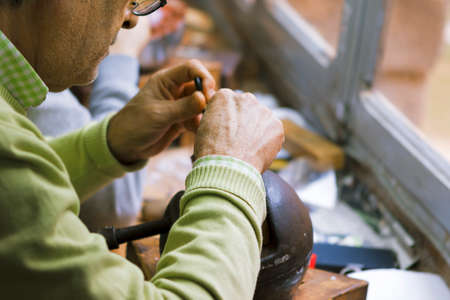 Toledo, Spain- November 04, 2015: Artisan jewelers creating hand made jewelry items in a workshop. Editorial