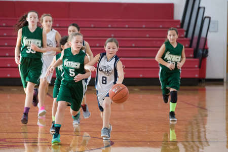 Staten Island, USA-December10,2016: Girl basketball OLHA team squares off with Team St.Patrick. Teams are sponsored by The Catholic Youth Organization of the Archdiocese of New York. 新闻类图片