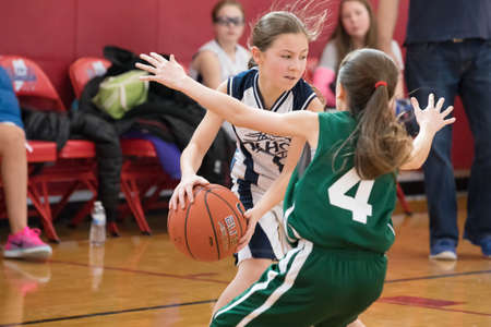 Staten Island, USA-December10,2016: Girl basketball OLHA team squares off with Team St.Patrick. Teams are sponsored by The Catholic Youth Organization of the Archdiocese of New York. Editorial