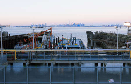 Staten Island, NY-February 19, 2917: View of Manhattan from Staten Island Ferry terminal. Ferry carries over 21 million passengers annually on the 5.2-mile (8.4 km) run.