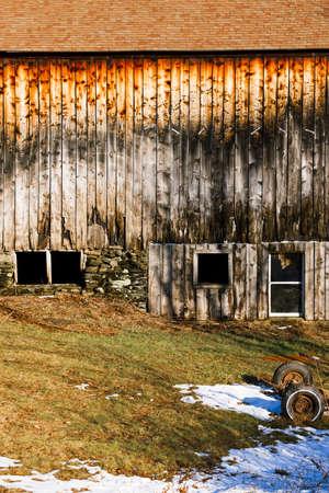 wood panel: Old weathered barn on a farmland. Stock Photo