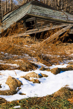 run down: Old weathered barn on a farmland. Stock Photo