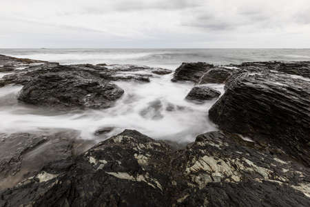 View of the rocky ocean shore Stock Photo