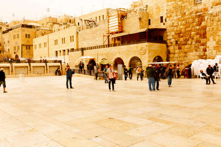spiritual architecture: Jerusalem, Israel-March 14, 2017: Jews pray at The Western Wall - the holiest place where Jews are permitted to pray, though it is not the holiest site in the Jewish faith, which lies behind it, on Temple Mount. Editorial