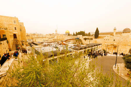 israeli: Jerusalem, Israel-March 12, 2017: Jews pray at The Western Wall - the holiest place where Jews are permitted to pray, though it is not the holiest site in the Jewish faith, which lies behind it, on Temple Mount. Editorial