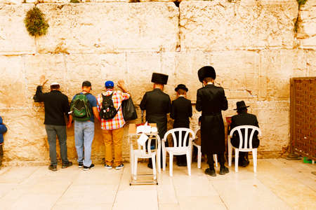 kotel: Jerusalem, Israel-March 14, 2017: Jews pray at The Western Wall - the holiest place where Jews are permitted to pray, though it is not the holiest site in the Jewish faith, which lies behind it, on Temple Mount. Editorial