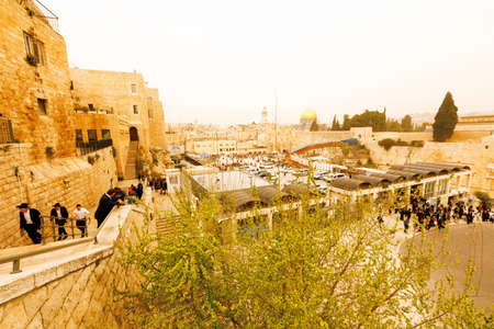 Jerusalem, Israel-March 12, 2017: Jews pray at The Western Wall - the holiest place where Jews are permitted to pray, though it is not the holiest site in the Jewish faith, which lies behind it, on Temple Mount. Editorial