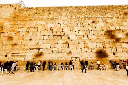 Jerusalem, Israel-March 14, 2017: Jews pray at The Western Wall - the holiest place where Jews are permitted to pray, though it is not the holiest site in the Jewish faith, which lies behind it, on Temple Mount. Editorial