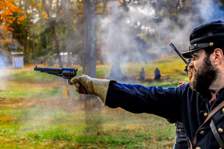 're: Coventry,RI,USA-October 28, 2017: Unknown local residents participating in a Civil War Era encampment and skirmish re-enactments. Editorial