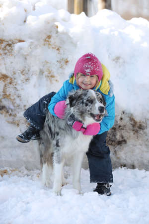 Girl playing with a Border Collie in nature photo