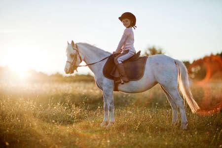 farm girl: Girl riding a horse on nature