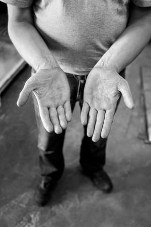 40 year old: Human hands working on the production. Mechanic powertrain. 40 year old