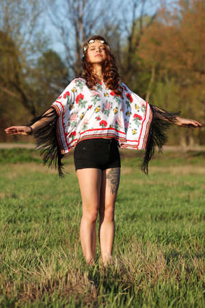rotates: Beautiful hippie girl with healthy hair is in place and rotates