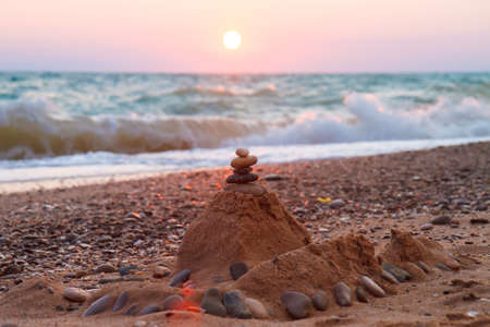 Figure of stones and sand against the setting sun. 写真素材
