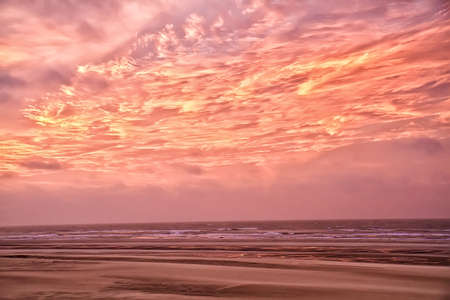Pink clouds at sunset. Coast of the North Sea. 写真素材