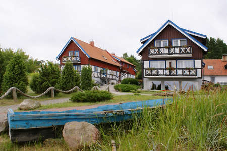 Traditional fishermans house in Nida, Lithuania. Nida is a resort settlement on the Curonian Spit in Lithuania.