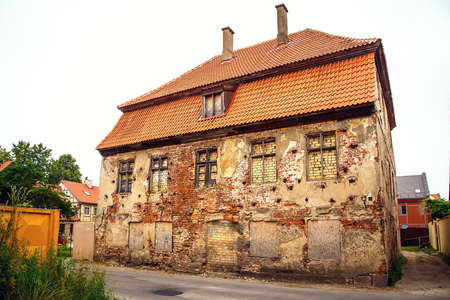 The old building has bricked windows. 写真素材