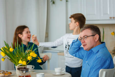 Photo session - friendly family. Dad is worried when children are naughty.