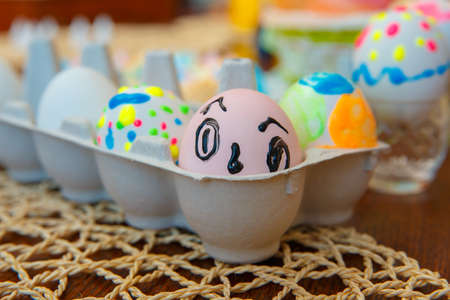 Funny painted eggs with bright colors. Fun brushes. Happy easter 写真素材