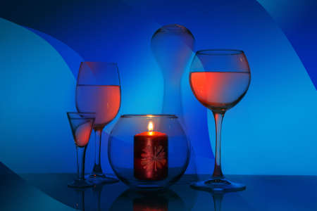 Glass fantasy with glasses and a candle. Glass still life