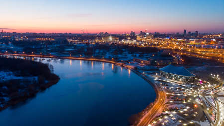 River and city lights early in the morning. Sunrise Minsk Belarus. Shooting a quadcopter.