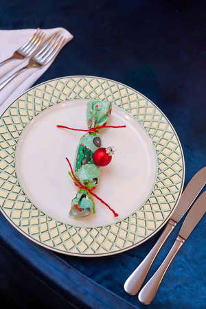 A surprise in the form of candy on a plate.