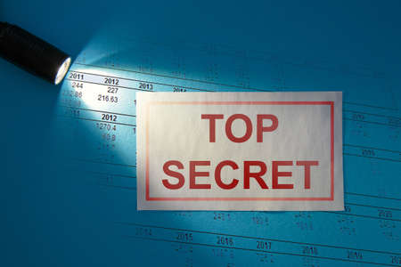 TOP SECRET - inscription on a white card in the beam of light