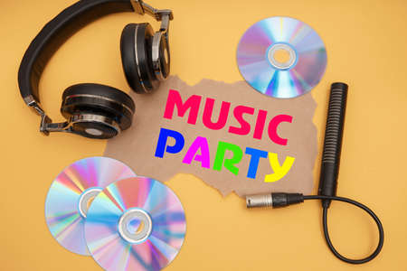 Headphones, microphone and music discs on a yellow background. Inscription MUSIC PARTY.