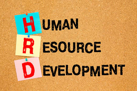 Notice office board with inscription HRD Human Resource Development