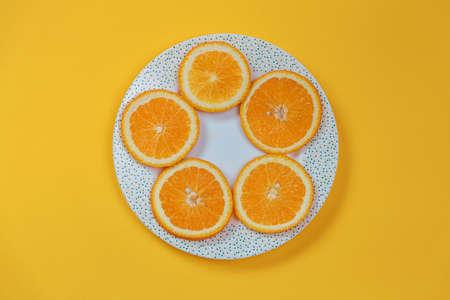 Orange slices on a plate. Diet concept