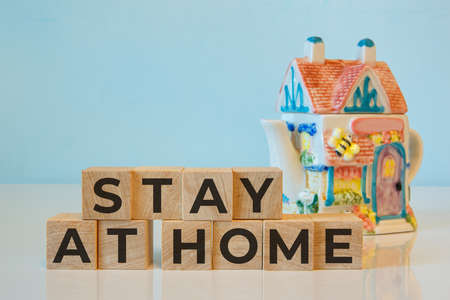 STAY AT HOME words written on wooden cubes. Concept home quarantine