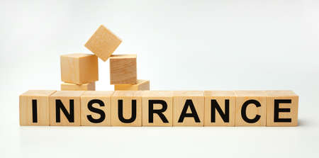 Wooden blocks with the word INSURANCE. Business concept Stok Fotoğraf