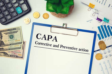 Paper with Corrective and Preventive action CAPA on the table, calculator and glasses Stok Fotoğraf