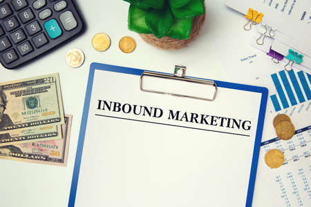 Blank with text Inbound Marketing on wooden surface, calculator, money