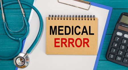 Notepad with text MEDICAL ERROR, calculator and stethoscope. Medical concept. Stock Photo