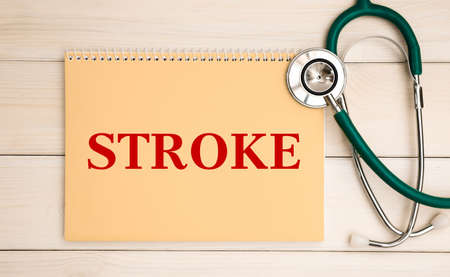 Card with text Stroke and stethoscope, medical concept.