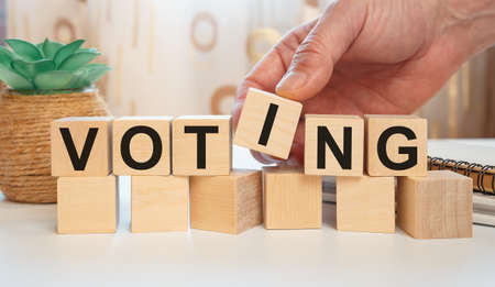 VOTING - word from wooden blocks on a white background Archivio Fotografico