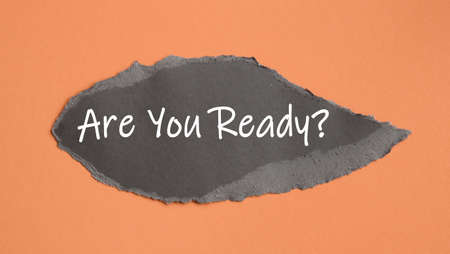 Are You Ready - appearing behind torn brown paper. Motivation encouragement quote.