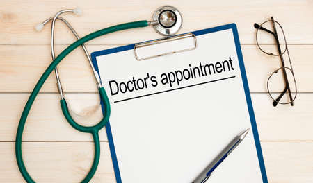 The doctor wrote - Doctor's appointment, stethoscope, glasses, pen on the table