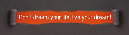 Don't dream your life, live your dream text on red background appears behind torn paper