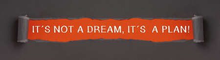 It's not a dream, it's a plan - text on red background appears behind torn paper
