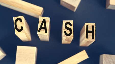 CASH - Word Written on Wooden Cubes. Concept