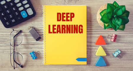 Deep learning is written in a notebook on an office table with office supplies. Stockfoto