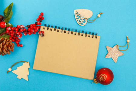 Craft notebook for inscriptions congratulations on a blue background, glasses and Christmas toys
