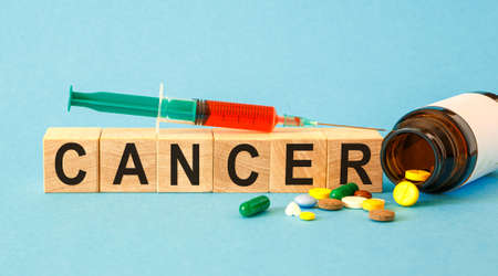 CANCER - word from wooden blocks with letters. Medical concept.